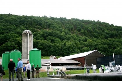 silo, buildings, people outside facility