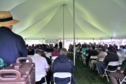 audience under tent listening to speakers