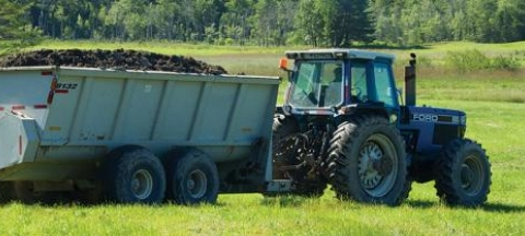 Farm tractor loaded with biosolids for spreading
