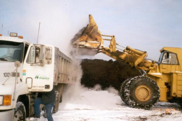 Truck loading compost for delivery