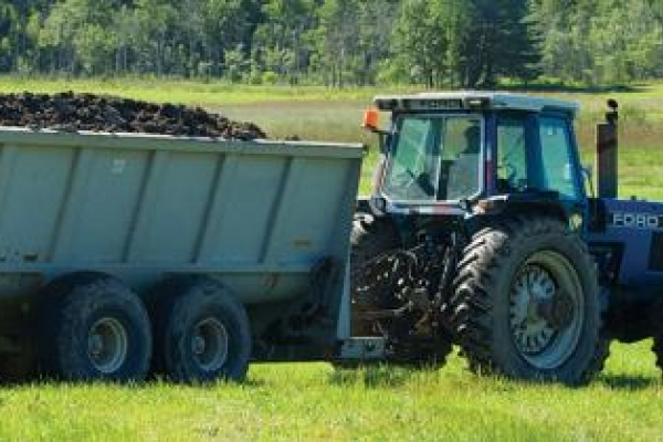 Tractor loaded with biosolids